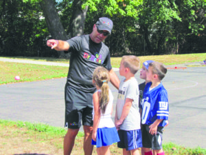 PlayFit creator Curt Hinson instructed Lee Road Elementary School students on how to play Dr. Recess Kickball.